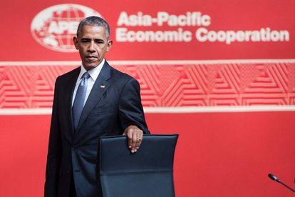 Obama, antes de tomar assento no fórum da APEC no Peru.