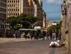 A man lies down as riot police and anti-Bolsonaro protesters clash in Recife, Brazil, May 29, 2021. INSTAGRAM @hugomunizzz via REUTERS  ATTENTION EDITORS - THIS IMAGE HAS BEEN SUPPLIED BY A THIRD PARTY. NO RESALES. NO ARCHIVES. MANDATORY CREDIT.