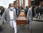 Relatives of Javier Ordonez, who died in police custody, carry his coffin after a funeral Mass in Bogota, Colombia, Wednesday, Sept. 16, 2020. Violent protests erupted after Ordóñez died early Wednesday the previous week following a confrontation caught on video by witnesses showing two officers pinning him down and tasering him while he begged them to stop. He was taken to a police precinct and later a hospital, where authorities say he arrived without vital signs. (AP Photo/Fernando Vergara)