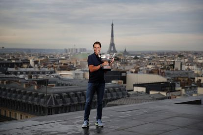 Spain's Rafael Nadal poses with his trophy during a photo call on the rooftop of Galeries Lafayette, Monday, Oct. 12, 2020, after winning Sunday the final match of the French Open tennis tournament against Serbia's Novak Djokovic in three sets, 6-0, 6-2, 7-5 at the Roland Garros stadium. (AP Photo/Francois Mori)