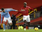 12 December 2020, England, Manchester: Manchester City's Ferran Torres (L) and Manchester United's Paul Pogba battle for the ball during the English Premier League soccer match between Manchester United and Manchester City at Old Trafford. Photo: Phil Noble/PA Wire/dpa 12/12/2020 ONLY FOR USE IN SPAIN