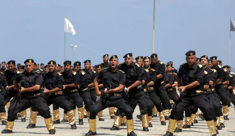 Membros militares do Hamas durante uma cerimônia, no dia 16 de junho.