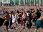Police officers asks people to not sit while patrolling at the beach in Barcelona, Spain, Wednesday, May 20, 2020. Barcelona permitted Wednesday for people to walk on its beaches for the first time since the start of the coronavirus lockdown over two months ago. Sunbathing and recreational swimming are still not allowed. (AP Photo/Emilio Morenatti)