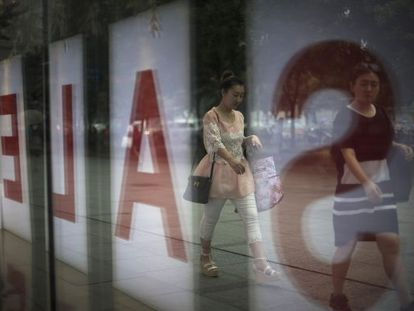 Uma vitrine em promoção, em Pequim.