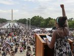 """WASHINGTON, DC - AUGUST 28: 12-year-old Yolanda Renee King, the granddaughter of Rev. Martin Luther King Jr., thrusts her fist as she speaks to the """"Get Your Knee Off Our Necks"""" Commitment March on Washington 2020 from the spot where her grandfather delivered his """"I Have a Dream"""" speech 57 years ago at the Lincoln Memorial August 28, 2020 in Washington, DC. Today marks the 57th anniversary of Rev. Martin Luther King Jr.'s """"I Have A Dream"""" speech at the same location.   Chip Somodevilla/Getty Images/AFP == FOR NEWSPAPERS, INTERNET, TELCOS & TELEVISION USE ONLY =="""