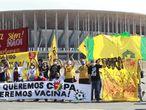 People protest Brazil's hosting the soccer Copa America tournament amidst the COVID-19 pandemic and against Brazil's President Jair Bolsonaro in Brasilia, Brazil, Sunday, June 13, 2021. (AP Photo/Ailton de Freitas)