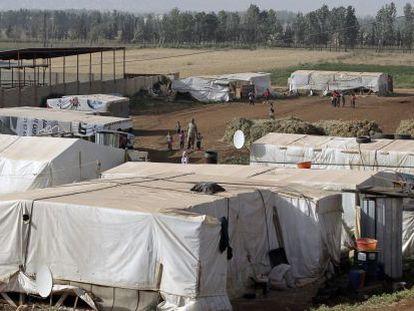 Refugiados sírios na fronteira com Líbano em 19 de junho.