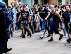 Berlin (Germany), 09/05/2020.- Right wing protestors attack police officers during a gathering on the Alexanderplatz in Berlin, Germany, 09 May 2020. According to a spokesperson of the Berlin police a group of people moved from the surrounding of the so-called 'hygiene demonstration' at the Volksbuehne at Rosa-Luxemburg-Platz to Alexanderplatz. As moving in bigger groups still is prohibited due to the covid-19 security measures police started detaining participants at Alexanderplatz. The motivation of the people to gather was unclear. (Atentado, Protestas, Alemania) EFE/EPA/FILIP SINGER