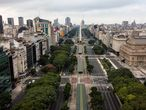 (FILES) File photo taken on March 30, 2020 of an aerial view of the empty 9 de Julio Avenue in Buenos Aires amid a lockdown due to the new coronavirus pandemic. - Almost six months after it was first detected in Latin America, the coronavirus death toll has reached 250,000 and exacerbated the problems of poverty and inequality, threatening to undo a decade of slow social progress. (Photo by RONALDO SCHEMIDT / AFP)
