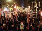Nurses march with torches to demand increases in their salary, professional recognition, and better working conditions in Buenos Aires, Argentina, Wednesday, May 12, 2021, amid the new coronavirus. (AP Photo/Victor R.Caivano)