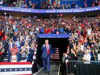 President Donald Trump, center, walk toward the stage while supporters cheer during his campaign rally at BOK Center in Tulsa, Okla., Saturday, June 20, 2020. (Ian Maule/Tulsa World via AP)