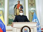 "Handout picture released by the Venezuelan Presidency showing Venezuela's President Nicolas Maduro giving a new speech before the annual General Assembly's virtual summit, from Miraflores Presidential Palace in Caracas on September 23, 2020, amid the COVID-19 novel coronavirus pandemic. - On his first pre-recorded speech on Monday, Maduro called for the world to fight against ""hegemony"" and ""imperialist ideas."" Maduro, accused by UN investigators of crimes against humanity, denounced ""the world of hegemony, the world of imperialism"" and insisted on the need to be ""united"" in the face of the coronavirus pandemic. (Photo by Marcelo GARCIA / Venezuelan Presidency / AFP) / RESTRICTED TO EDITORIAL USE - MANDATORY CREDIT ""AFP PHOTO / VENEZUELA'S PRESIDENCY / MARCELO GARCIA"" - NO MARKETING - NO ADVERTISING CAMPAIGNS - DISTRIBUTED AS A SERVICE TO CLIENTS"