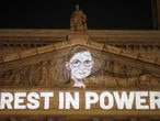 FILE PHOTO: An image of Associate Justice of the Supreme Court of the United States Ruth Bader Ginsburg is projected onto the New York State Civil Supreme Court building in Manhattan, New York City, U.S. after she passed away September 18, 2020. REUTERS/Andrew Kelly/File Photo