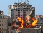 The al-Jalaa building housing Associated Press (AP) and Al Jazeera media offices is hit by an Israeli air strike in Gaza City, May 15, 2021. REUTERS/Ashraf Abu Amrah  NO RESALES. NO ARCHIVES.