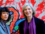 (FILES) This file photo taken on October 21, 2015 shows French researcher in Microbiology, Genetics and Biochemistry Emmanuelle Charpentier (L) and US professor of Chemistry and of Molecular and Cell Biology, Jennifer Doudna posing beside a painting made by children of the genoma at the San Francisco park in Oviedo. - Emmanuelle Charpentier of France and Jennifer Doudna of the US on Tuesday, October 7, 2020 won the Nobel Chemistry Prize for research into the gene-editing technique known as the CRISPR-Cas9 DNA snipping tool. (Photo by Miguel RIOPA / AFP)