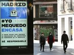 An ad advising people to be responsible and stay home is displayed at the almost empty Preciados street due to the coronavirus outbreak in central Madrid, Spain, March 14, 2020. REUTERS/Sergio Perez