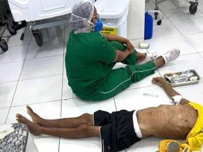 Imagem que percorreu as redes sociais do idoso morto no chão de uma UPA em Teresina