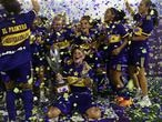 Boca Juniors' players celebrate winning Argentina's soccer female league championship after defeating River Plate 7-0, at Jose Amalfitani stadium in Buenos Aires, Argentina, Tuesday, Jan. 19, 2021. (Juan Roncoroni/Pool via AP)
