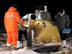 Researchers work next to Chang'e-5 lunar return capsule carrying moon samples, after it landed in northern China's Inner Mongolia Autonomous Region, December 17, 2020. China Daily via REUTERS ATTENTION EDITORS - THIS IMAGE WAS PROVIDED BY A THIRD PARTY. CHINA OUT.