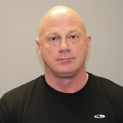 This undated photo provided by the GrapevineTexas Police Department shows, Larry Rendall Brock Jr. Brock, a retired Air Force officer was arrested in Texas and charged in federal court in the District of Columbia with one count of knowingly entering or remaining in any restricted building or grounds without lawful authority and one count of violent entry and disorderly conduct on Capitol grounds,prosecutors said. During the deadly riotWednesday, Jan. 6, 2021, Brock was photographed on the Senate floor wearing a helmet and heavy vest and carrying zip-tie handcuffs (GrapevineTexas Police Department via AP)