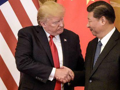 Trump, à esquerda, com o líder chinês, Xi Jinping, em novembro em Pequim.