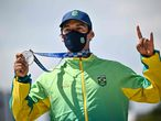 Silver medallist Brazil's Kelvin Hoefler poses on the podium at the end of the men's street prelims during the Tokyo 2020 Olympic Games at Ariake Sports Park Skateboarding in Tokyo on July 25, 2021. (Photo by Jeff PACHOUD / AFP)