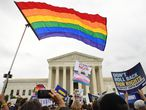 (FILES) In this file photo taken on October 08, 2019 Demonstrators in favour of LGBT rights rally outside the US Supreme Court in Washington, DC, as the Court holds oral arguments in three cases dealing with workplace discrimination based on sexual orientation. - The US Supreme Court ruled June 15, 2020 that federal protections against workplace discrimination apply equally to sexual orientation, contrary to the position taken by the administration of President Donald Trump. (Photo by SAUL LOEB / AFP)