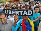 Opposition demonstrators take part in a protest against the government of President Nicolás Maduro.