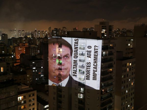 "An image of Brazil's President Jair Bolsonaro with the phrase ""How many deaths until impeachment"" is projected on a building during a protest against his policies for the coronavirus disease (COVID-19) outbreak and Manaus' health crisis at Santa Cecilia neighbourhood in Sao Paulo, Brazil January 15, 2021. REUTERS/Amanda Perobelli"
