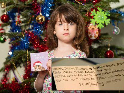 Florence Widdicombe, de seis anos, posa com o cartão natalino da Tesco onde encontrou a mensagem de um preso estrangeiro na China.