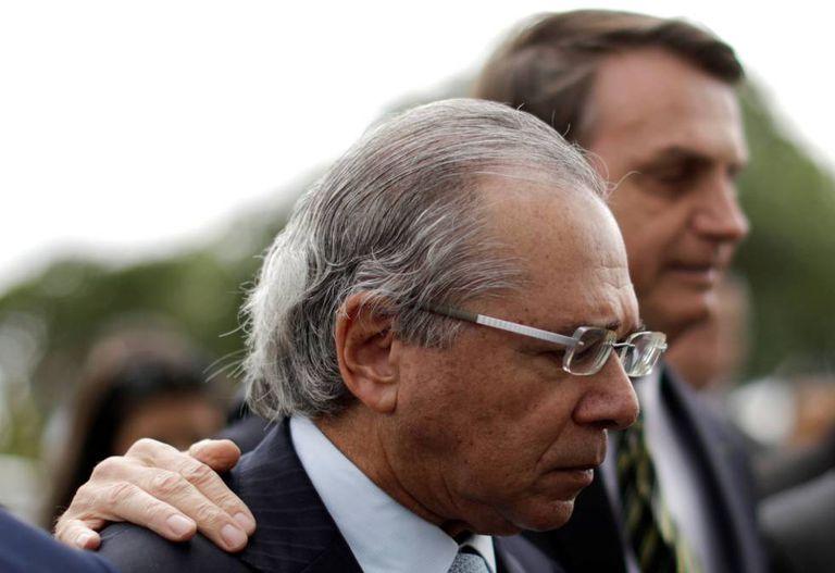 Ministro da Economia, Paulo Guedes, ao lado do presidente Jair Bolsonaro.