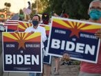 "Members of the group ""Arizona Republicans Who Believe In Treating Others With Respect"" hold signs in support of Democratic presidential candidate Joe Biden, during evening rush hour in Phoenix, Arizona on October 16, 2020. - Arizona has not elected a Democrat since Bill Clinton's second win in 1996, but is undergoing major demographic changes. The state best known abroad for the Grand Canyon is seeing a rapid growth in urban areas, among young college-educated voters, and in its robust Latino community -- groups that tend to favor the Democratic Party. But key to next month's election is that the average Arizona voter, whether Republican or Democrat, tends to be more moderate and is ""tired of the President's behavior and the rhetoric coming from his campaign,"" according to Arizona State University politics lecturer Gina Woodall. (Photo by Robyn Beck / AFP)"