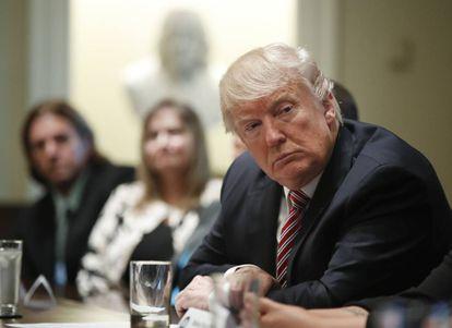 """Donald Trump com """"vítimas de crimes da migração"""" quarta-feira na Casa Branca."""