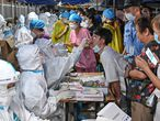 A medical worker collects a swab from a resident during a mass testing for the coronavirus disease (COVID-19) at a makeshift testing site in Guangzhou, Guangdong province, China May 30, 2021. Picture taken May 30, 2021. cnsphoto via REUTERS  ATTENTION EDITORS - THIS IMAGE WAS PROVIDED BY A THIRD PARTY. CHINA OUT.