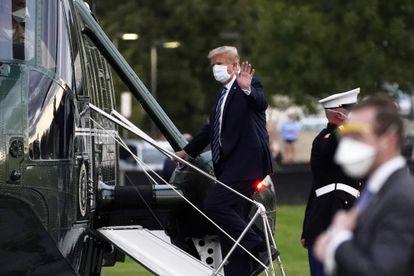 O presidente Donald Trump entrando no Marine One em Bethesda, Maryland.