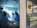Medical workers take care of a patient at the intensive care unit (ICU) of the Nossa Senhora da Conceicao hospital, during the coronavirus disease (COVID-19) outbreak, in Porto Alegre, Brazil, November 19, 2020. Picture taken November 19, 2020. REUTERS/Diego Vara