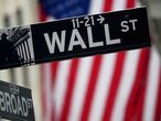 FILE PHOTO: A Wall Street sign is pictured outside the New York Stock Exchange in the Manhattan borough of New York City, New York, U.S., October 2, 2020. REUTERS/Carlo Allegri/File Photo