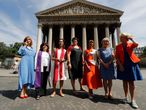 "(FILES) In this file photo taken on July 22, 2020 (From L) Helene Pichon, Christina Moreira, Loan Rocher, Marie-Automne Thepot, Sylvaine Landrivon, Anne Soupa and Laurence de Bourbon Parme, members of the collective ""Toutes apotres"" (All apostles) pose in front of La Madeleine Church in Paris, on July 22, 2020, as they have decided to apply publicly at the Paris' Apostolic Nunciature for various ministries, which are forbidden to them within the Catholic church. (Photo by FRANCOIS GUILLOT / AFP)"