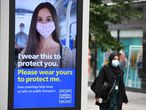 A pedestrian wears a facemask in the city centre of Leeds, on July 23, 2020, as lockdown restrictions continue to be eased during the novel coronavirus COVID-19 pandemic. - The wearing of facemasks in shops in England will be compulsory from Friday, but full guidance is yet to be published. (Photo by Oli SCARFF / AFP)