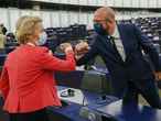 European Commission President Ursula von der Leyen greets European Council President Charles Michel during the plenary session of the European Parliament in Strasbourg, eastern France, Wednesday June 9, 2021. (Julien Warnand, Pool via AP)