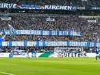 "Schalke's supporters display banners reading ""We apologize to all whores to link them to Mr Hopp"" before the German first division Bundesliga football match FC Schalke 04 vs 1899 Hoffenheim in Gelsenkirchen, western Germany, on March 7, 2020. (Photo by UWE KRAFT / AFP) / DFL REGULATIONS PROHIBIT ANY USE OF PHOTOGRAPHS AS IMAGE SEQUENCES AND/OR QUASI-VIDEO"