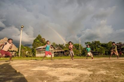 Indigenous children play soccer in the Turriquitadó Llano community, which houses other indigenous people displaced by the violence.