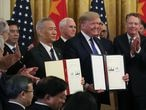 WASHINGTON, DC - JANUARY 15: U.S. President Donald Trump and Chinese Vice PremierLiuHe, hold up signed agreements of phase 1 of a trade deal between the U.S. and China, in the East Room at the White House, on January 15, 2020 in Washington, DC. Phase 1 is expected to cut tariffs and promote Chinese purchases of U.S. farm,and manufactured goods while addressing disputes over intellectual property. (Photo by Mark Wilson/Getty Images)