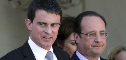 O presidente François Hollande (à dir.), e o premiê, Manuel Valls.