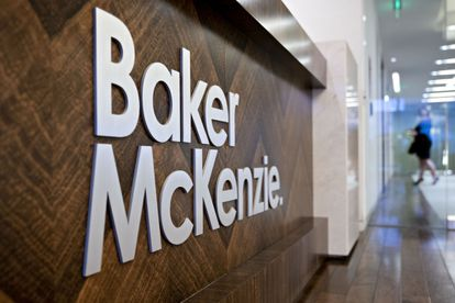 Signage is displayed at the Baker McKenzie office in Washington, D.C., U.S., on Tuesday, Feb. 18, 2020. Hong Kong-based Milton Cheng was elected Baker McKenzie's first Asian-born global chair last September following the sudden death in April of its former leader Paul Rawlinson. Photographer: Andrew Harrer/Bloomberg