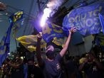 Supporters of Bruno Covas, mayor of Sao Paulo, celebrate his re-election during the municipal election in Sao Paulo, Brazil, November 29, 2020. REUTERS/Amanda Perobelli