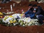 Relatives react near the grave of Neusa Freitas dos Santos, 81, who died from the coronavirus disease (COVID-19), after the burial at Vila Formosa cemetery, in Sao Paulo, Brazil, July 16, 2020. REUTERS/Amanda Perobelli