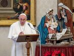 """This photo taken on January 10, 2021 and handout on January 11, 2021 by the Vatican Media shows Pope Francis holding a weekly live streamed Angelus prayer by a Nativity Scene, from the library of the apostolic palace in The Vatican, during the COVID-19 pandemic caused by the novel coronavirus. (Photo by Handout / VATICAN MEDIA / AFP) / RESTRICTED TO EDITORIAL USE - MANDATORY CREDIT """"AFP PHOTO / VATICAN MEDIA"""" - NO MARKETING - NO ADVERTISING CAMPAIGNS - DISTRIBUTED AS A SERVICE TO CLIENTS"""