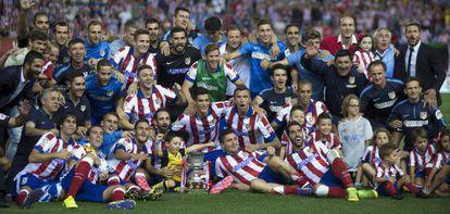 O Atlético comemora o título.