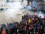 FILE PHOTO: Police release tear gas into a crowd of pro-Trump protesters during clashes at a rally to contest the certification of the 2020 U.S. presidential election results by the U.S. Congress, at the U.S. Capitol Building in Washington, U.S, January 6, 2021. REUTERS/Shannon Stapleton/File Photo